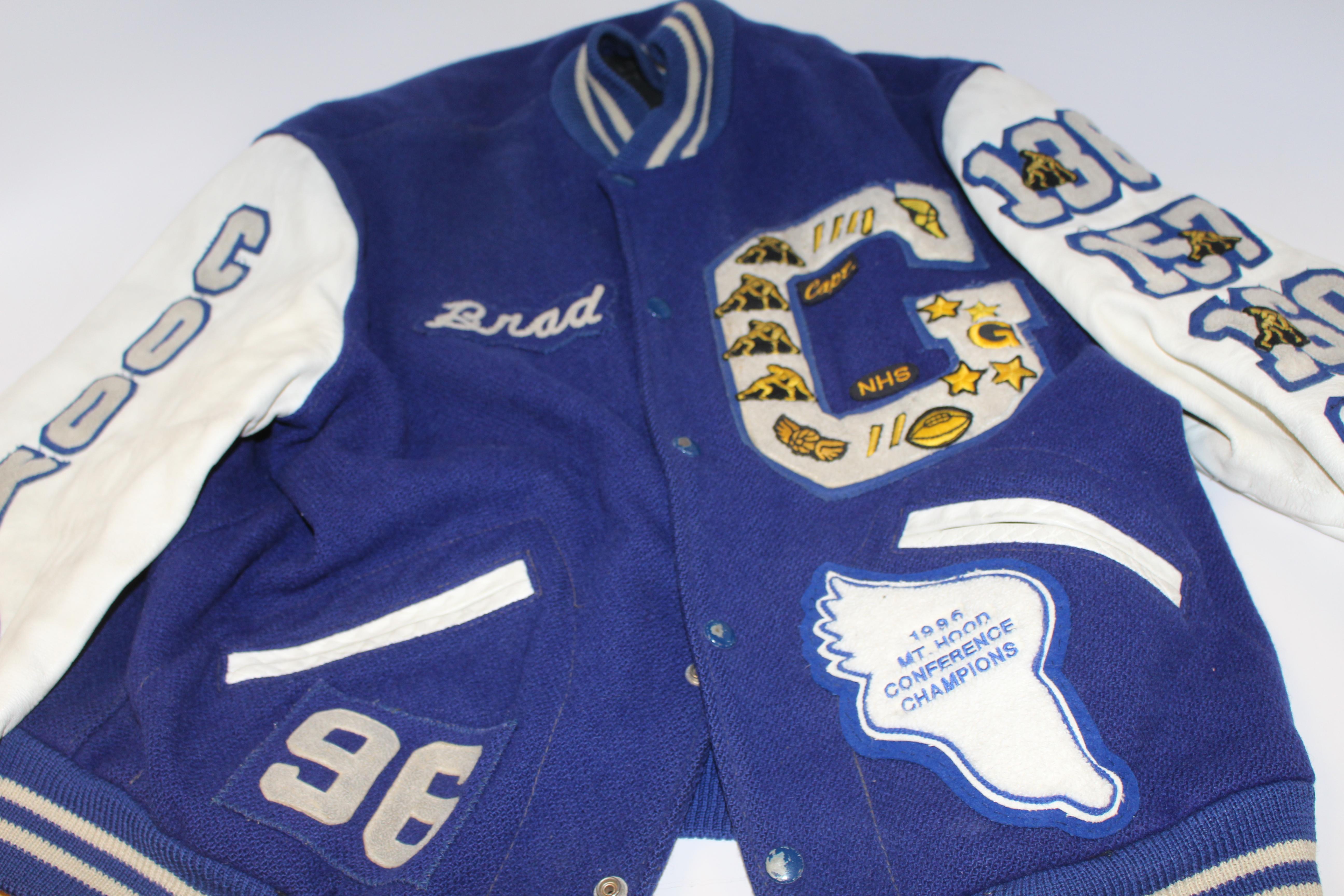 Graphic Design teacher Brad Cook's varsity letterman jacket from 1996.