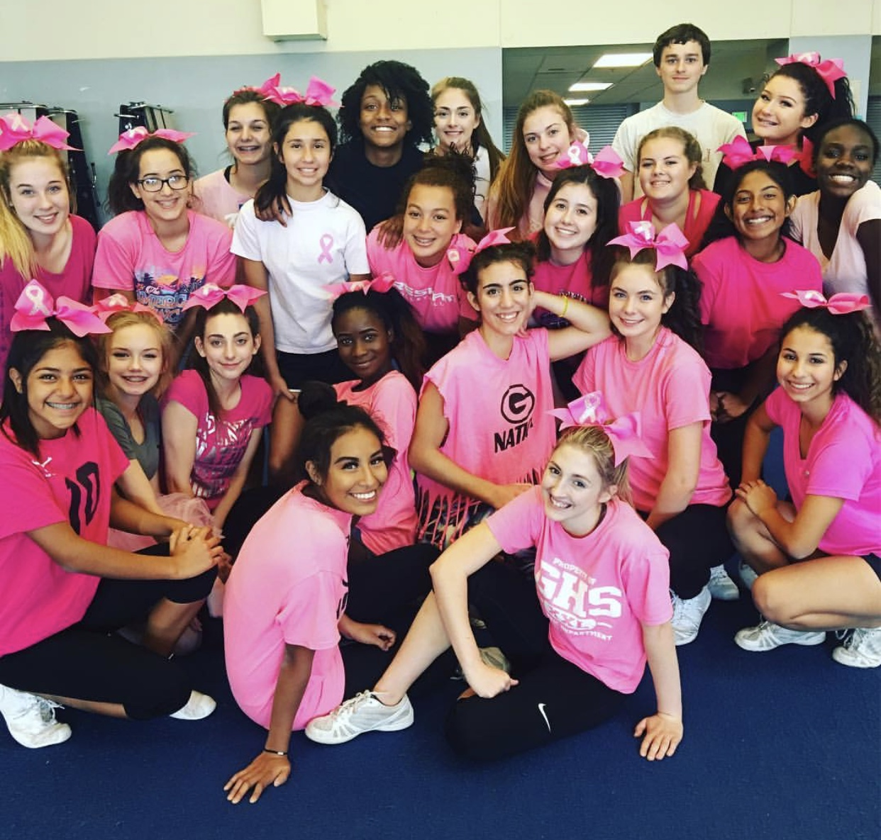 Gresham cheer team poses for the camera during practice.