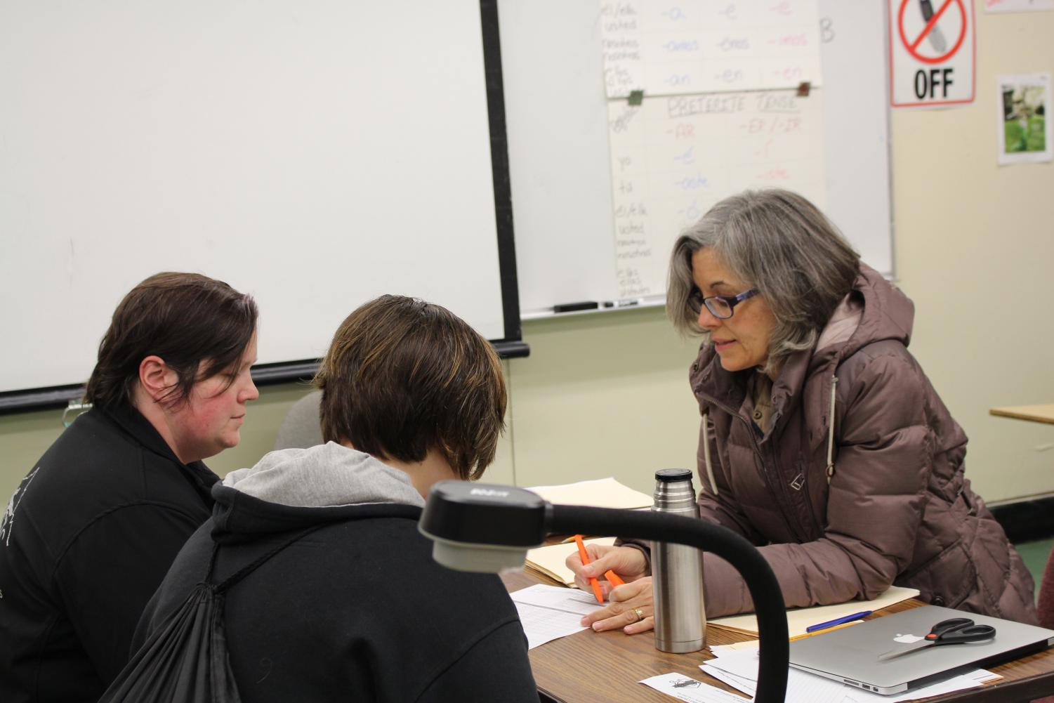 Spanish teacher Mrs. Cavanagh during a conference with one of her Spanish 3-4 students
