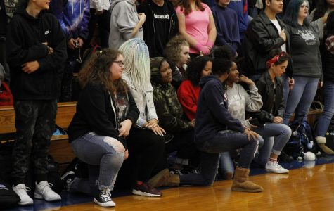 Students organize kneeling movement at school-wide assemblies