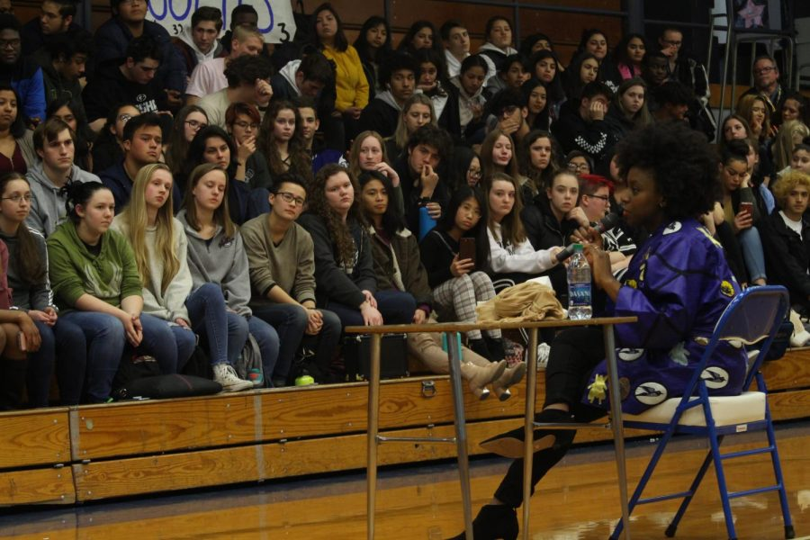 Adichie+speaking+to+the+students+at+assembly+on+March+14th.