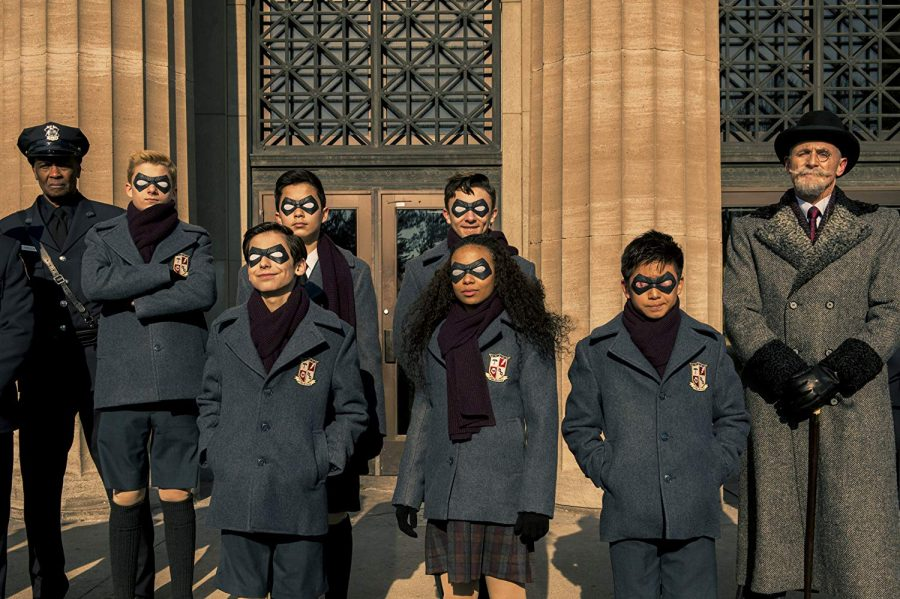 The Umbrella Academy students in front of a bank.