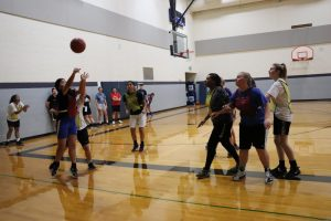 Tenzin Yangchen shooting during the first day of basketball tryouts.