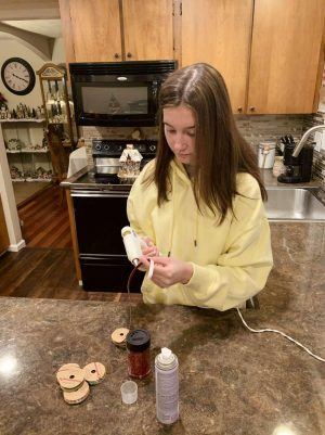 Marissa Moss shows her holiday spirit by prepping some ribbon for her DIY gift.
