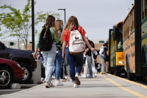 Students boarding the bus after a day of on-campus learning.